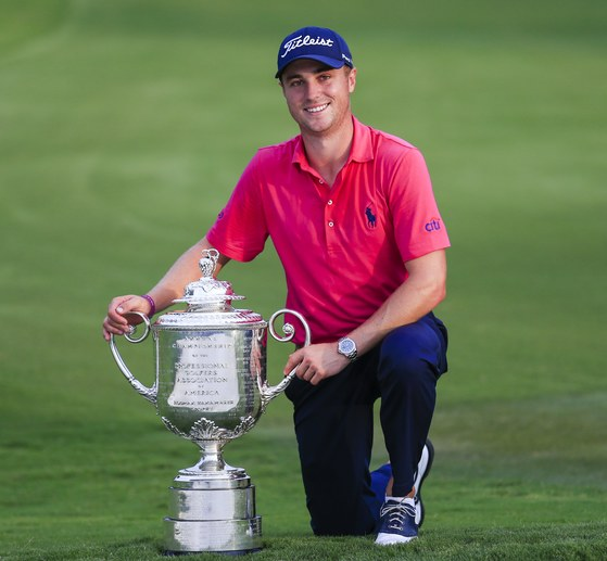 epa06143424 Justin Thomas of the USA poses with the Wanamaker Trophy after winning the 99th PGA Championship golf tournament at Quail Hollow Club in Charlotte, North Carolina, USA, 13 August 2017. EPA/TANNEN MAURY