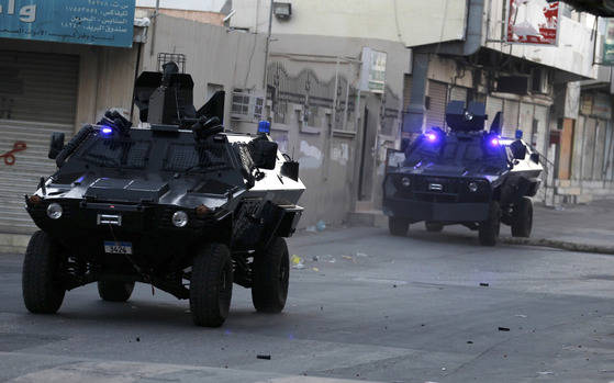 [BAHRAIN-PROTEST]Police Armoured Personnel Carriers are seen entering the village of Sanabis, west of Manama, during a protest that attempted to march back to Al Farook Junction, formally known as Pearl Square, in the village of Sanabis, west of Manama, February 14, 2012. Anti-government protesters tried to march from all directions to reach to the junction but riot police dispersed them by firing tear-gas, rubber bullets and sound grenades. At least 25 protesters have been arrested throughout the daylong