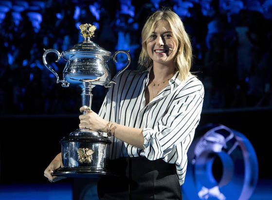 Former ladies single's champion Russia's Maria Sharapova poses for a photo with the Daphne Akhurst Memorial Cup on Margaret Court Arena during the ceremony for the official draw at the Australian Open tennis championships in Melbourne, Australia Thursday, Jan. 11, 2018. (AP Photo/Mark Baker) <저작권자(c) 연합뉴스, 무단 전재-재배포 금지>