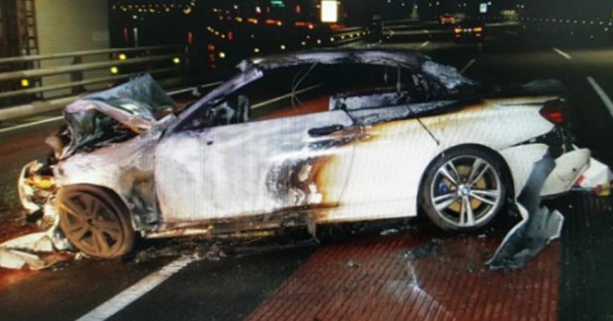 부산 광안대교서 BMW 차량이 앞서 달리던 제네시스를 들이받아 4명이 크고 작은 부상을 입었다. 사진은 전소된 BMW 차량의 모습. [사진 부산경찰청]