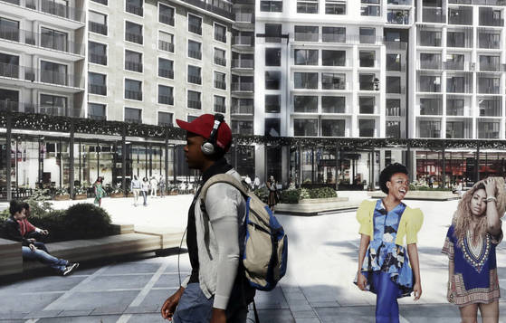"""CORRECTS THAT THE MAN IS WALKING PAST A POSTER, NOT BUILDINGS. ALSO CORRECTS DATE PHOTO WAS MADE - FILE - In this Sept. 19, 2017, file photo, a man walks past a poster advertising apartments in Sandton, north Johannesburg, South Africa. The blockbuster film """"Black Panther"""" has created a new compelling vision of Africa as a continent of smart, technologically savvy people with cool clothes living in a futuristic city amid stunning landscapes. (AP Photo/Themba Hadebe, File) <저작권자(c) 연합뉴스, 무단 전재-재배포 금지>"""