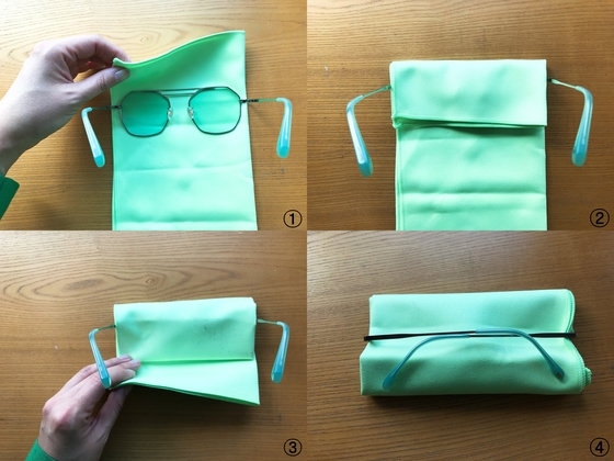안경수건으로 선글라스 렌즈 감싸기.