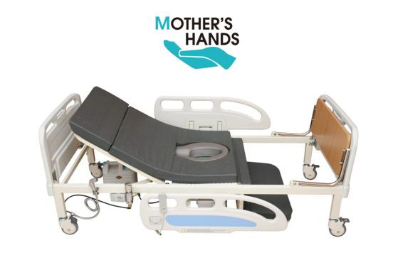 마더스핸즈 변기부착침대. 거동이 불편한 환자를 위해 수세식 변기가 부착되어 있다. [사진 마더스핸즈]