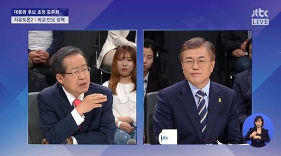 """[대선 4차 TV토론] 洪 """"5ㆍ18 가산점은 되고 군 가산점은 안되나""""… 文""""그렇다"""""""