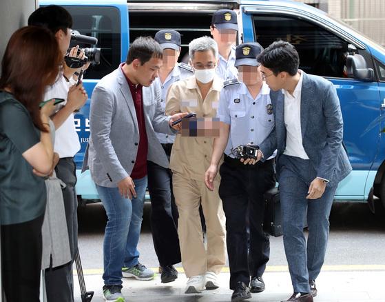 지난 17일 소환조사를 받기 위해 특검 사무실에 출석한 드루킹 김동원씨. [연합뉴스]