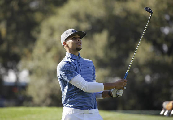 FILE - In this Oct. 12, 2016, file photo, Golden State Warriors' Stephen Curry follows his shot from the 14th fairway of the Silverado Resort North Course during the pro-am event of the Safeway Open PGA golf tournament, in Napa, Calif. Two-time NBA MVP Stephen Curry is set to test his golf game against the pros. The Web.com Tour announced Wednesday, June 28, 2017, that Curry, who recently won his second NBA championship with the Golden State Warriors, will play in the Ellie Mae Classic. The event at TPC Stonebrae runs from Aug. 3-6.(AP Photo/Eric Risberg)