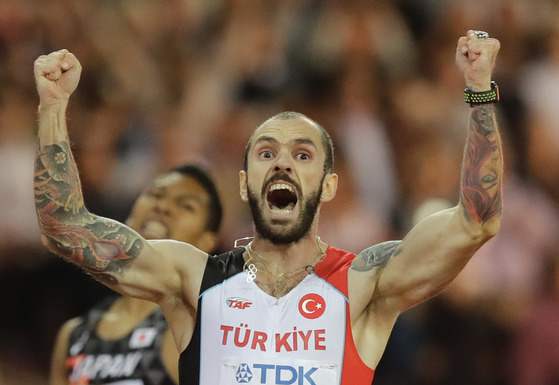 Turkey's Ramil Guliyev crosses the line to win gold in the men's 200-meter final during the World Athletics Championships in London Thursday, Aug. 10, 2017. (AP Photo/Tim Ireland)