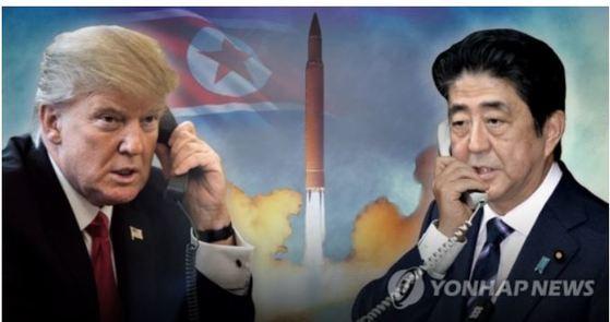 도널드 트럼프 미 대통령과 아베 신조 일본 총리가 3일 오전 전화 통화를 했다. 지난달 29일 북한이 일본 상공을 통과한 미사일을 발사한 뒤 엿새 사이 세번째 통화다.[연합뉴스]