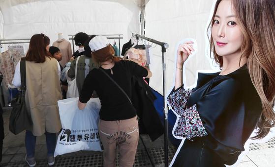 22일 서울 광화문광장에 마련된 '김희선 프리미엄존'에서 시민들이 물건을 고르고 있다. [강정현 기자]