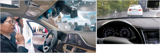 원모터스코리아는 서울시 R&D지원사업의 도움으로 차량용 헤드업 디스플레이 제품 론칭과 홍보를 했다. 왼쪽 사진은 지난 4월 열린 2017서울모터쇼에서 원모터스코리아 부스를 방문한 고객이 전시 차량에서 직접 시연하고 있는 모습. [사진 SBA 서울R&D지원센터]