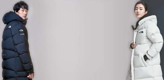 '스키 다운 코트'를 입고 있는 노스페이스 홍보대사 소지섭(왼쪽)과 '익스플로링 코트'를 착장한 노스페이스 홍보대사 강소라. [사진 노스페이스]