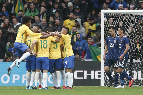 Brazil's players celebrates Marcelo's side second goal with teammates during their international friendly soccer match Brazil against Japan at the Pierre Mauroy stadium in Lille, northern France, Friday, Nov. 10, 2017. (AP Photo/Michel Spingler)