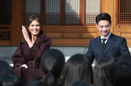 Minho (right) standing next to the U.S. First Lady Melania Trump (left)