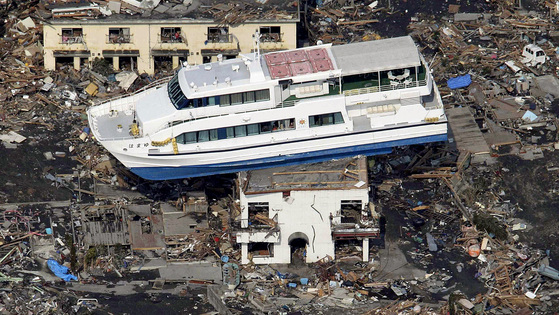 A ferry stranded on a building is seen in Otsuchi, Iwate Prefecture, northern Japan, Sunday, March 13, 2011, two days after a powerful earthquake-triggered tsunami hit the country's east coast. (AP Photo/The Yumiuri Shimbun) JAPAN OUT, CREDIT MANDATORY