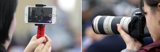 지난 10월 서울 용산구 합동참모본부에서 열린 합동참모본부 등에 대한 국회 국방위원회의 국정감사에서 보좌관들이 의원의 질의 모습을 각가 스마트폰으로 기록하고 있다. 중앙포토