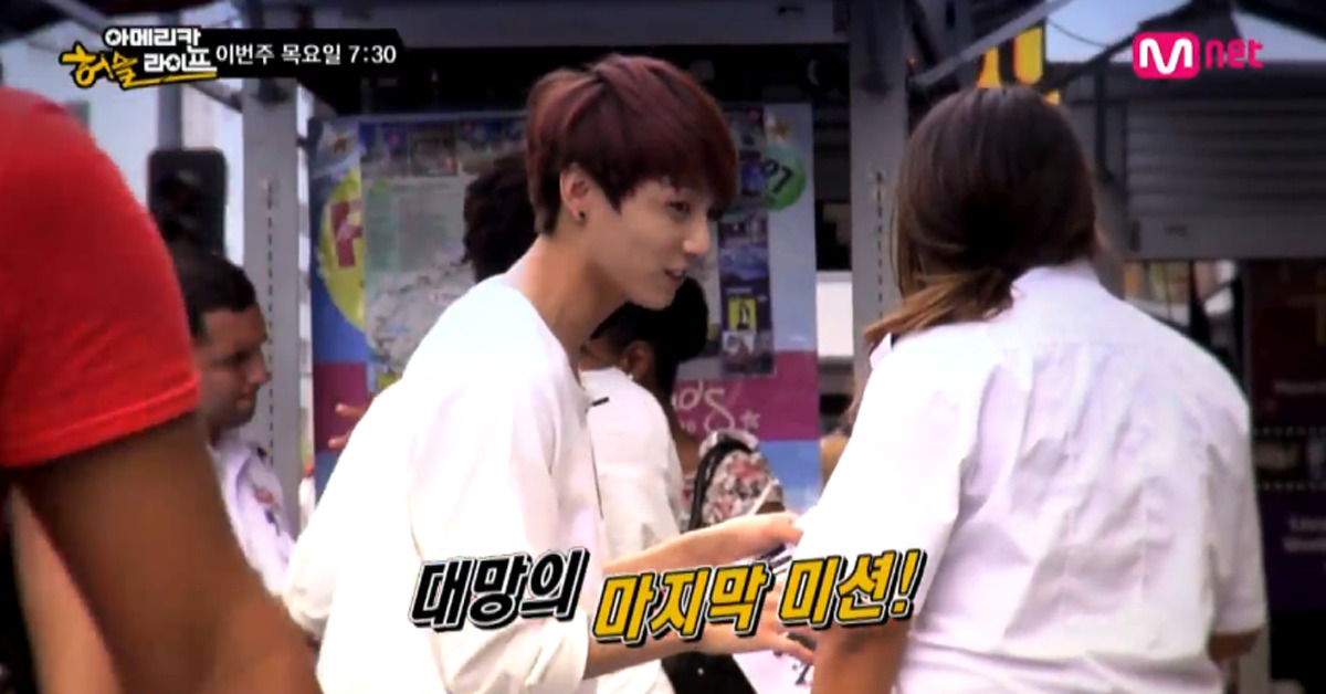 BTS handing out flyers. [photo from Mnet]