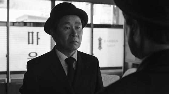 영화 <메리 크리스마스 미스터 모>의 주인공 모금산 씨(기주봉 분).
