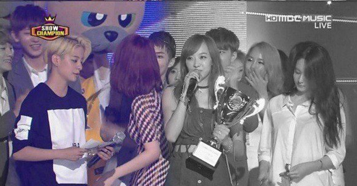Sulli and Chanyeol are talking to each other away from the other f(x) members.