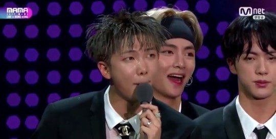 RM Receiving the 'Artist of the Year' award. Photo from Mnet.
