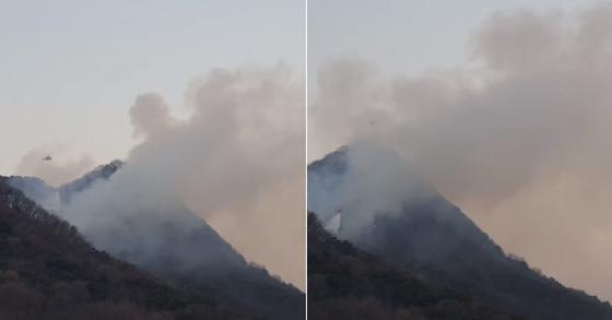 22일 경남 김해에서 발생한 산불을 소방 헬기가 진압하는 모습 [사진 김해뉴스 유튜브 캡처]