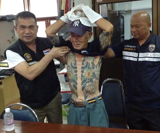 14년간 도피중이던 일본 야쿠자 두목 시게하루 시라이가 11일 태국 현지에서 체포됐다. [AFP=연합뉴스]