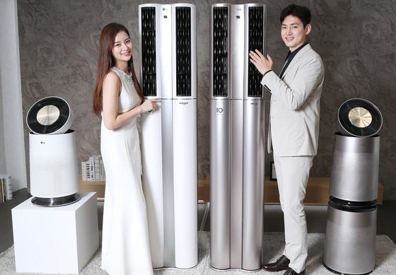 LG휘센 에어컨 신제품발표회가 18일 서울 여의도에서 열렸다. 모델들이 인공지능 플랫폼을 탑재한 휘센 씽큐에어컨 등 신제품을 선보이고 있다. [최승식 기자]