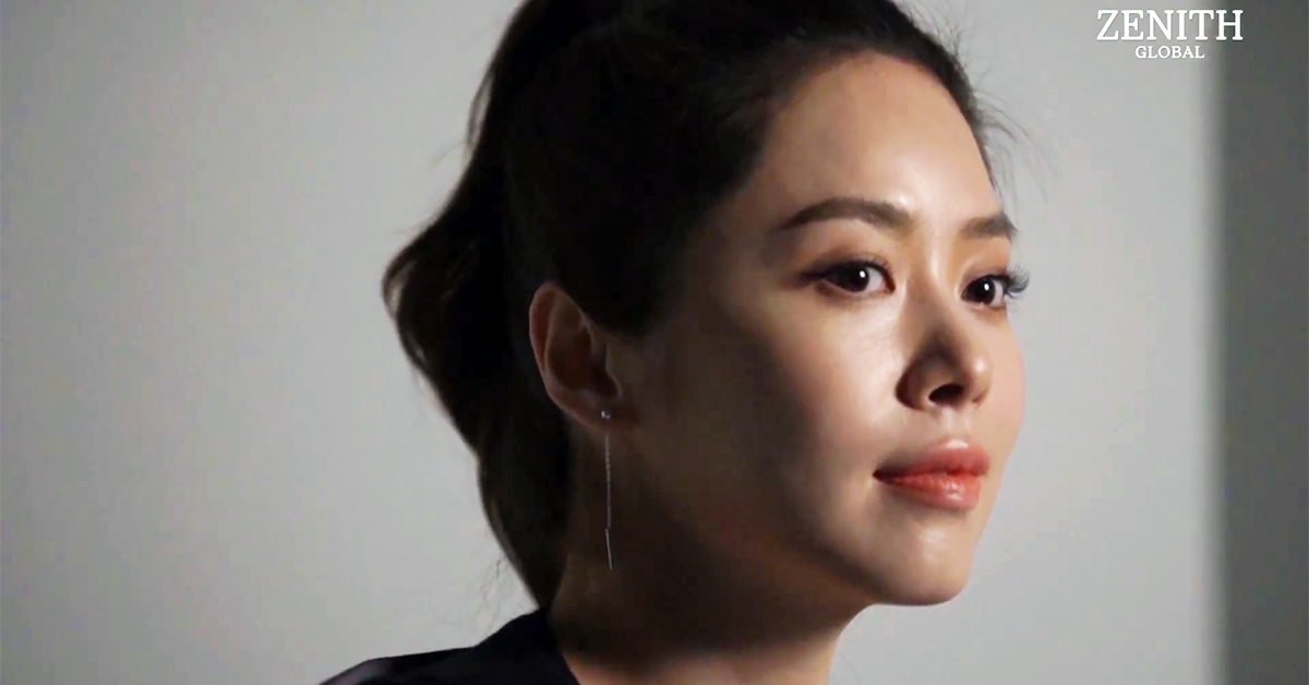 Grace Lee on a photo shoot with Zenith Global. Photo from Youtube.