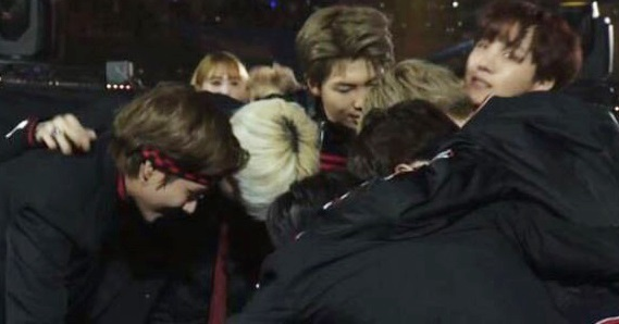 BTS hugging each other when announced as grand prize winners. Photo from online community.