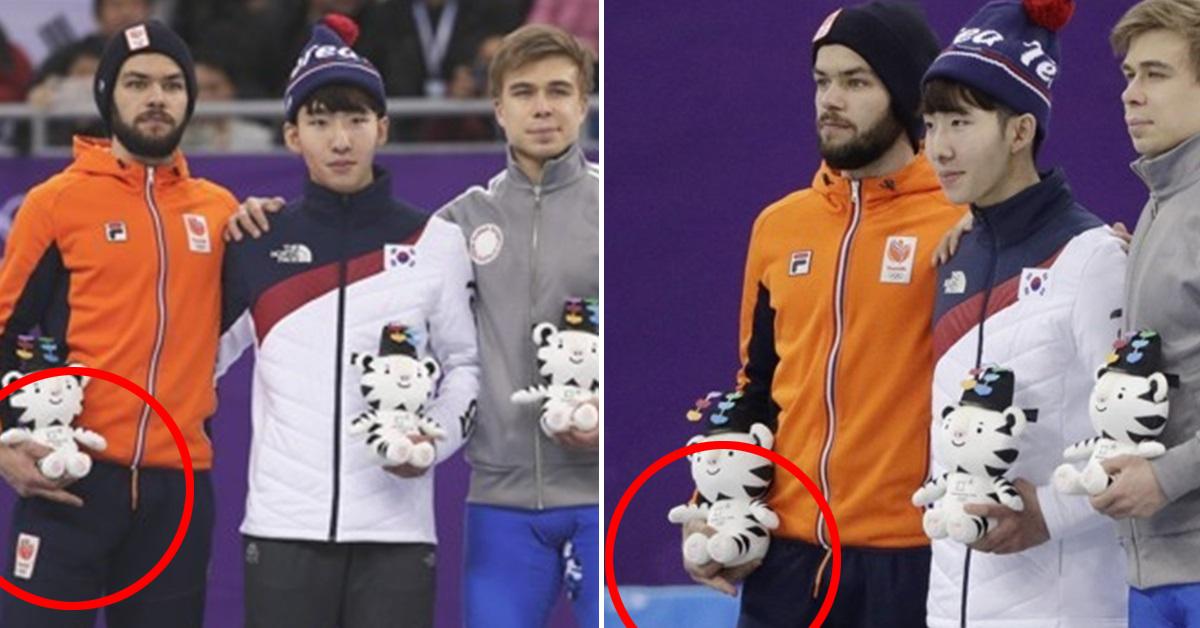 10일 강릉 아이스 아레나에서 열린 쇼트트랙 남자 1500m 시상식에서 자세를 취하는 네덜란드 싱키 크네흐트(왼쪽). [AP=연합뉴스]
