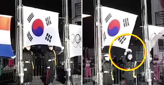 11일 진행된 남자 쇼트트랙 1500m 시상식에서 국기 게양 도중 군인의 모자가 태극기 오른쪽에 걸리는 돌발 상황이 일어났다. [사진=위키트리 영상 캡처]