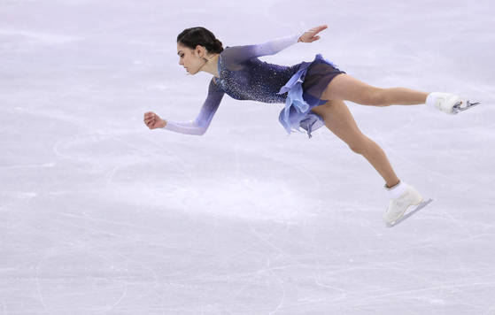 Evgenia Medvedeva performing at Gangneung Ice Arena for the win at Pyeongchang Winter Olympics. Photo by YONHAP.