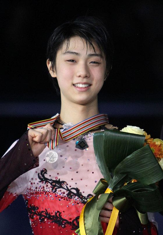 2011년 2월 4대륙선수권 대회에서 다카하시 다이스케에 이어 2위를 차지했다.