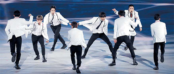 EXO performing at the closing ceremony of the Winter Olympics on February 25. Photo from KOREA POOL.