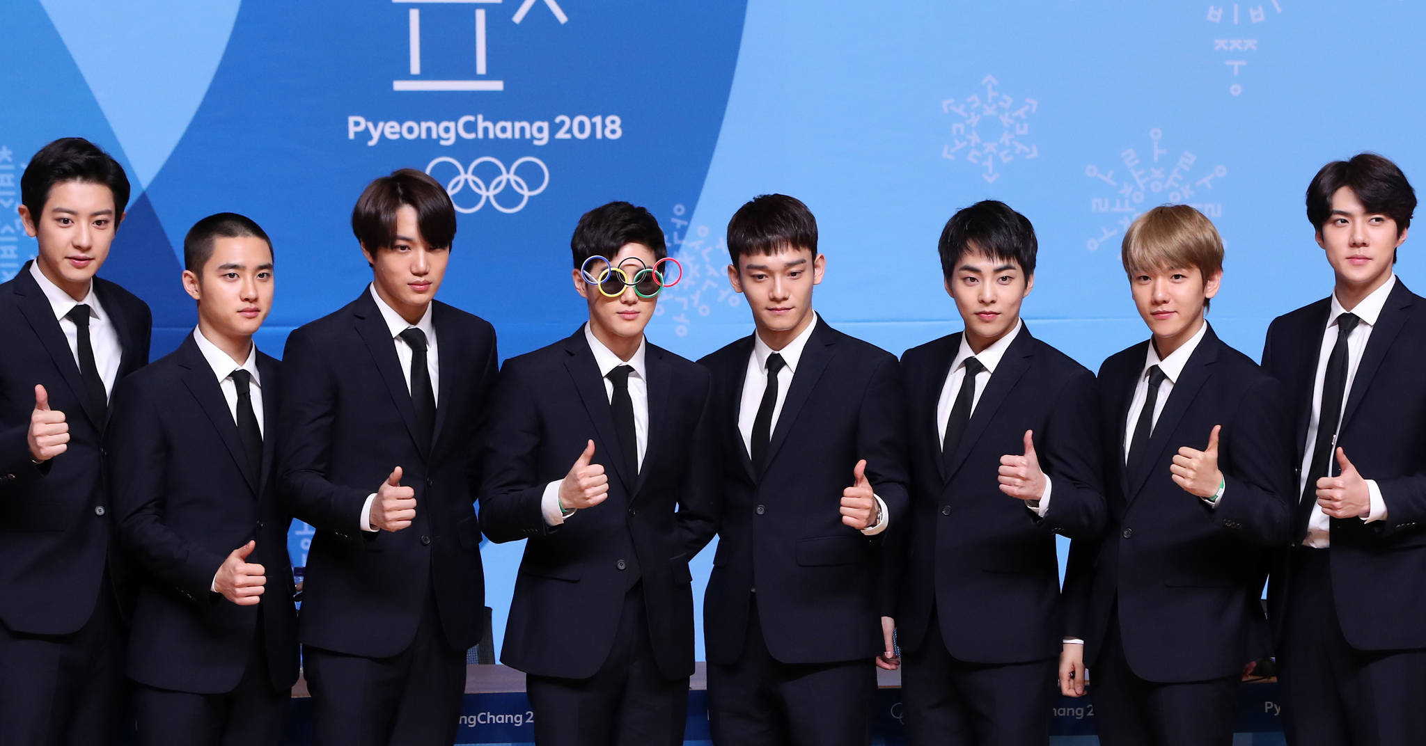 EXO members posing at a press conference for the closing ceremony of 2018 PyeongChang Winter Olympics on February 21 at the Main Press Centre in Alpensia Resort, PyeongChang.