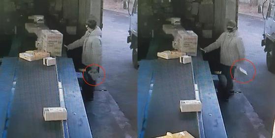 장모씨 등 2명이 택배 상자를 일부러 화물차 아래로 떨어뜨려 훔치는 모습.[사진 서초경찰서]