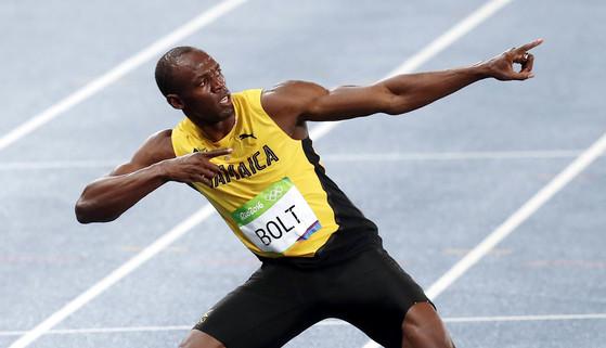 2016년 열린 리우올림픽 육상 남자 200m 결승 경기에서 19초 78의 기록으로 우승한 우사인 볼트가 세레머니를 펼치고 있다. [올림픽사진공동취재단]