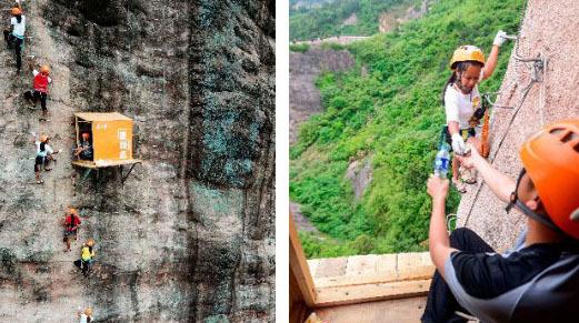 절벽 100m 위에 들어선 편의점에서 등반하던 산악인이 음료수를 사고 있다.[AFP=연합뉴스]