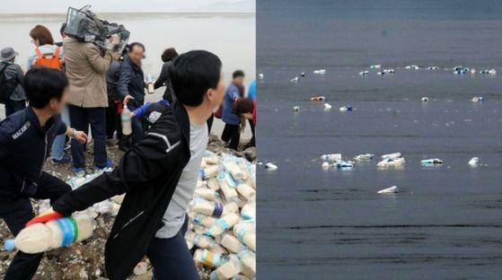 국내외 대북단체 회원들이 1일 인천 강화군 석모도에서 쌀과 USB, 미화1달러 등이 담긴 페트병을 바닷물에 실어 북한에 보내고 있다. [뉴스1]