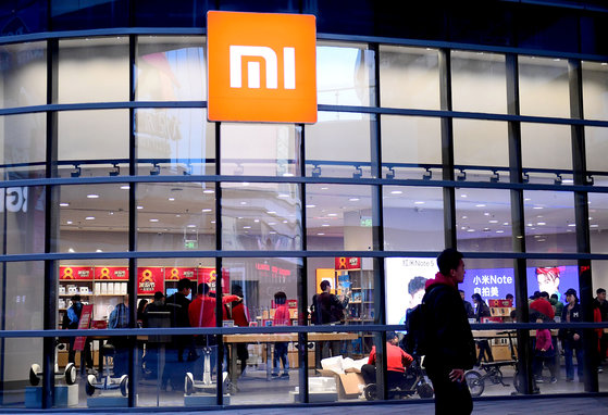 A man walks past a Xiaomi store in Shenyang, Liaoning province, China April 7, 2018. Picture taken April 7, 2018. REUTERS/Stringer ATTENTION EDITORS - THIS IMAGE WAS PROVIDED BY A THIRD PARTY. CHINA OUT.
