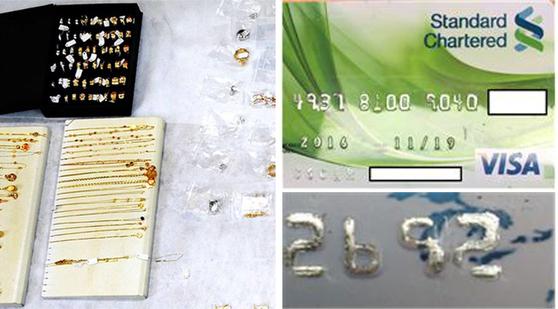 귀금속 자료사진(왼쪽)과 말레이시아 국적 외국인 3명이 결제에 활용한 위조 신용카드. [사진 중앙포토,·서울 혜화경찰서]