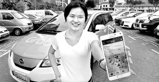 동남아 최대 차량 공유 플랫폼 '그랩'의 공동 창업자 탄 후이링. 그는 자전거부터 셔틀버스까지 모든 교통수단을 스마트폰으로 이용할 수 있는 서비스를 2012년 개발해 말레이시아에서 출시했다. [중앙포토]