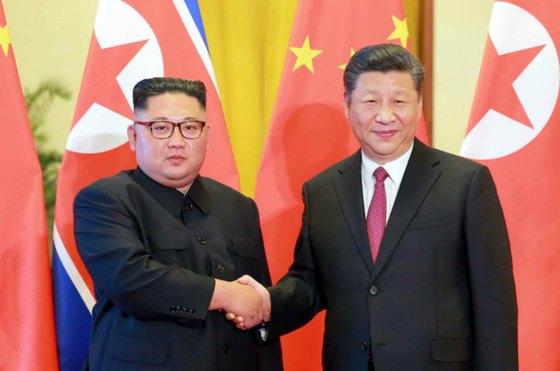 북한 노동신문이 김정은 국무위원장의 세 번째 방중 소식을 20일 보도했다. 김 위원장은 지난 19일 베이징에 도착, 시진핑(習近平) 중국 국가주석과 만났다. [노동신문=뉴스1]