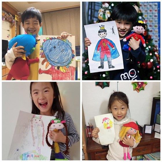 어린이들이 나만의 인형 프로젝트를 통해 박성일 대표가 선물한 인형을 들고 기념사진을 찍고 있다. [사진 박성일씨]