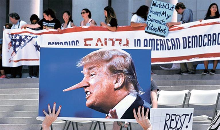 지난해 6월 트럼프 대통령의 러시아 스캔들 특검 수사 등을 요구하는 시위가 미국 주요 도시에서 열렸다.[연합뉴스]