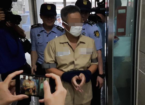 드루킹 김동원씨가 28일 오후 서울 서초구 특검 사무실로 소환되고 있다.[연합뉴스]