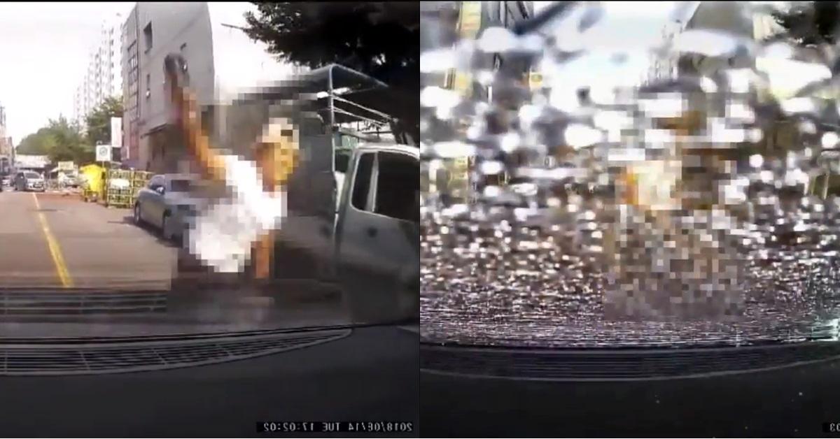 차 뒷유리에 유리병 던지는 남성. [사진 보배드림 영상 캡처]