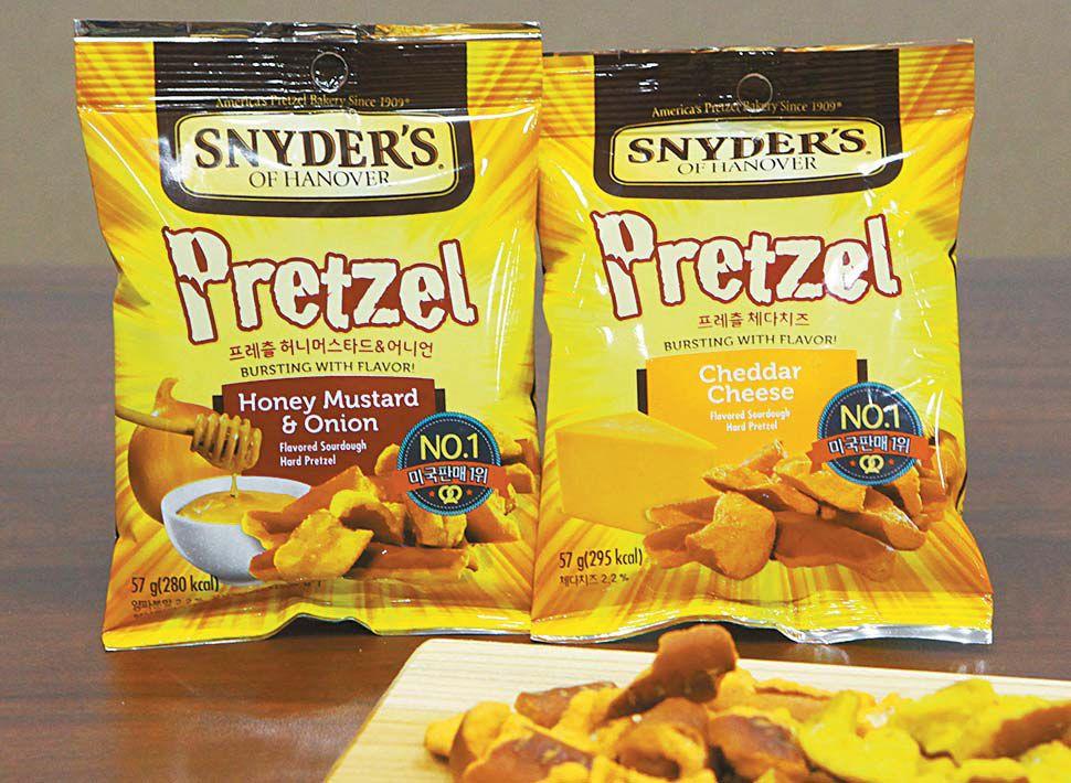 국내에 출시되는 프레츨은 '허니머스타드&어니언' '체다치즈' 2종이다. 2종 모두 미국 프레츨 시장에서 매출 10위권 내 들어가는 인기 제품이다. [사진 크라운제과]