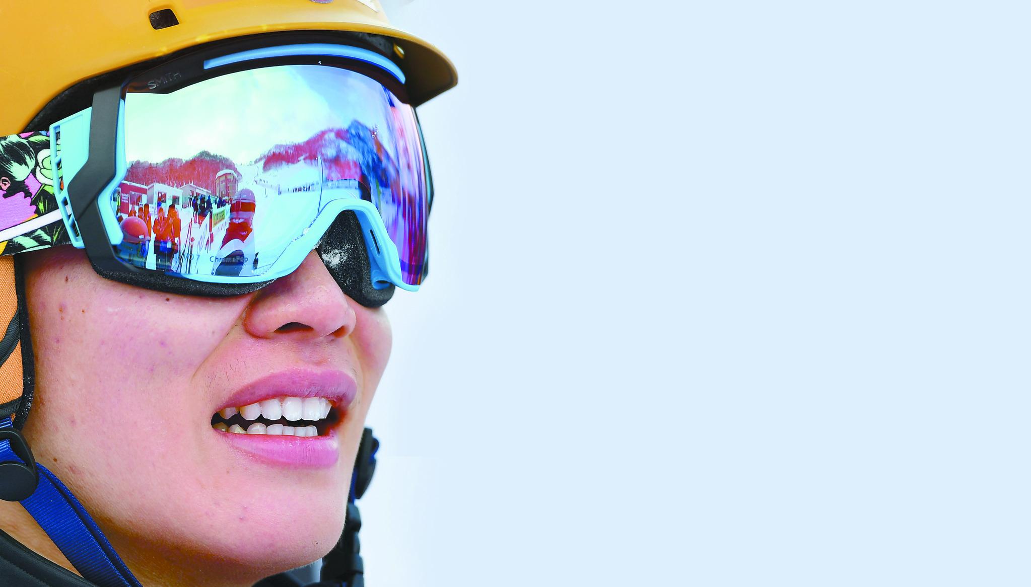 한국 알파인 스노보드 사상 최초로 겨울 아시안게임 금메달을 목에 건 이상호.[삿포로=뉴시스]