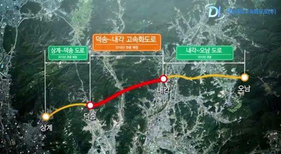 오는 14일 남양주 덕송 ~ 내각 고속화도로(4.901km)가 개통한다. 첫해 통행료는 소형차 1200원, 중대형차는 2200~2900원을 받는다. [사진 덕송내각고속화도로 사업단]
