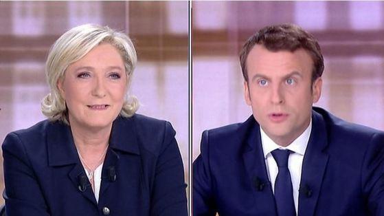3일(현지시간) 프랑스 BMFTV방송에서 토론 중인 대선 후보 마린 르펜(왼쪽)과 에마뉘엘 마크롱.